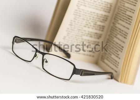 pen books and glasses on white background