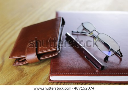 pen business wallet glasses notebook