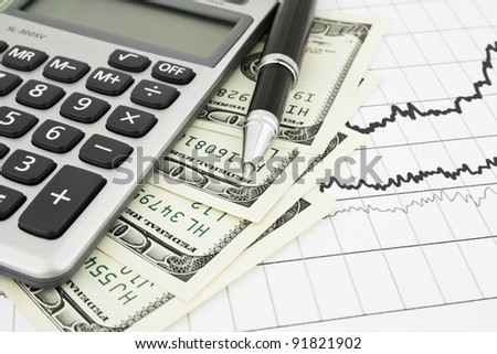 Pen,calculator and dollars on chart closeup. Business concept background - stock photo