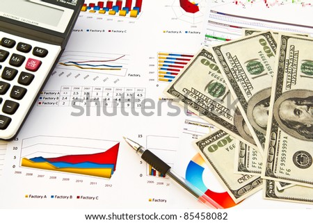 Pen ,calculator and dollars on financial Graphs