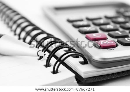 Pen, calculator and notebook close up - stock photo