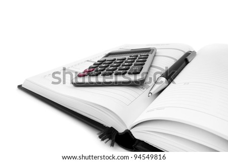Pen, calculator on notebook close up on white - stock photo