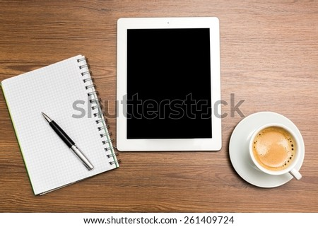 pen, coffee and tablet on the table, workplace businessman - stock photo