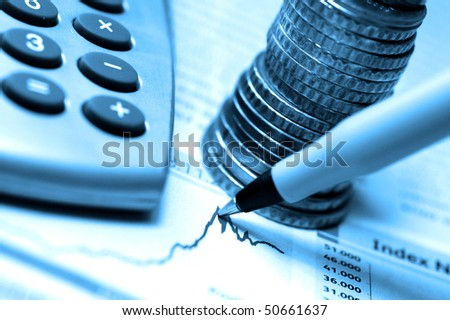 pen, coins and calculator on stock chart, blue tone