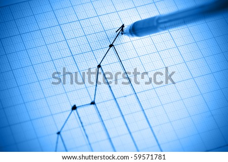 Pen drawing profit line graph. Shallow DOF! - stock photo