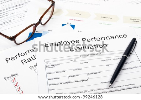 Pen, Glasses and Employee Performance Evaluation on desktop in business office. - stock photo