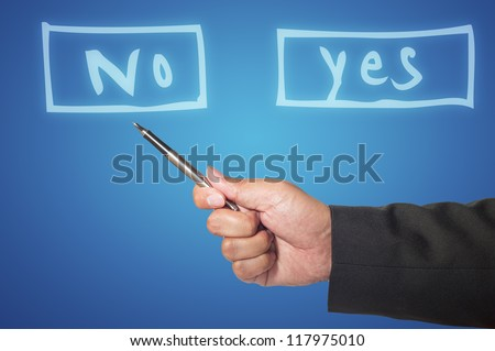 Pen in business hand with yes or no choice - stock photo