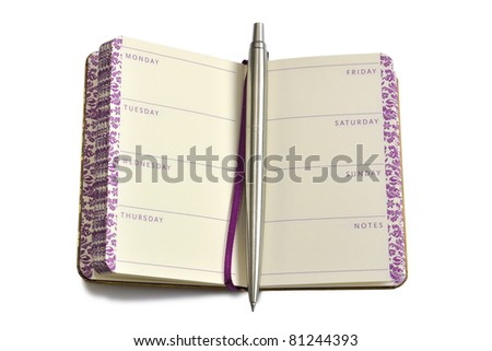 Pen in diary notebook with names of week days - stock photo