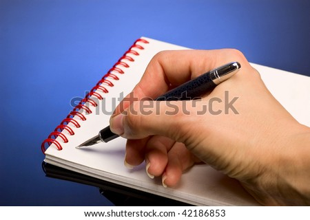 pen in hand isolated