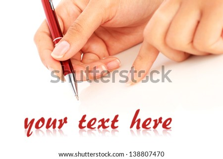 Pen in hand isolated over white. - stock photo