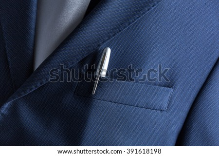 Pen in pocket of a business suit close up - stock photo