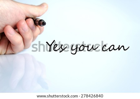 Pen in the hand isolated over white background Yes you can concept - stock photo