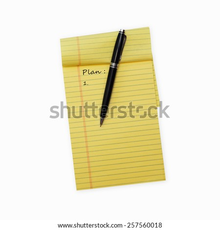 Pen laying on an opened note pad isolated on white background - stock photo