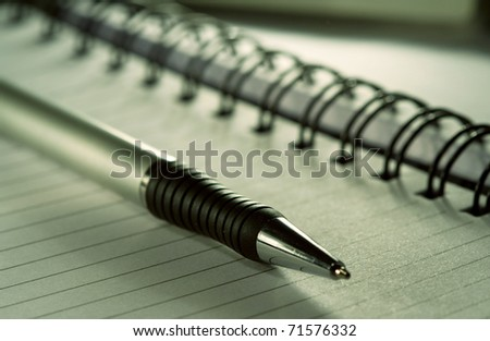 pen lying on a notebook - stock photo