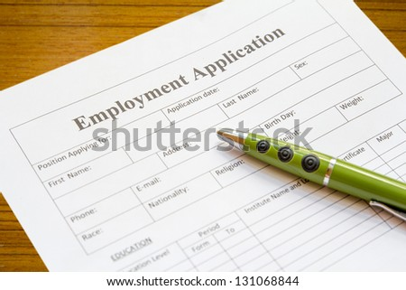 pen lying on the form of employment - stock photo