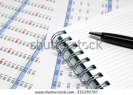 Pen, notebook, and business sheets