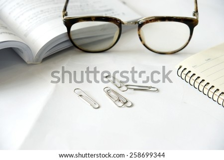 Pen notebook and eyeglasses