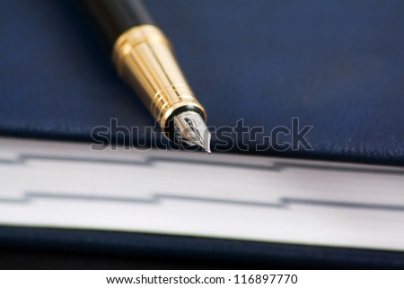 Pen on a closed diary - stock photo