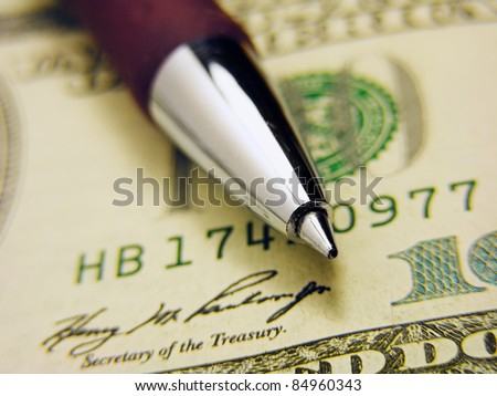 Pen on a dollar - stock photo