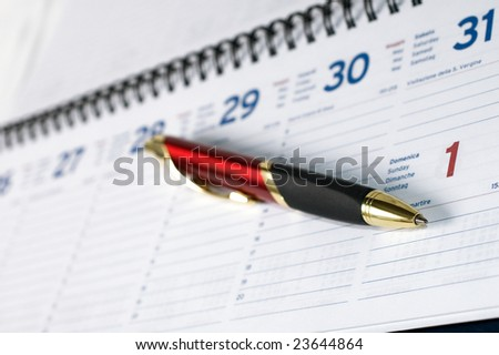 Pen on agenda page with shallow depth of filed