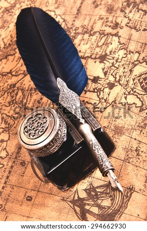 pen on an ancient map - stock photo