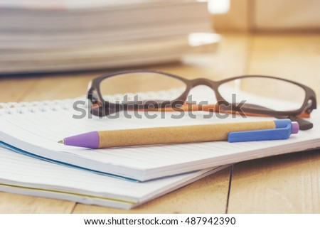 Pen on book ,business project thinking