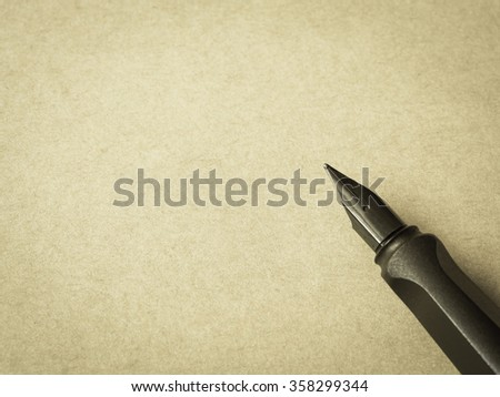 Pen on brown paper - stock photo
