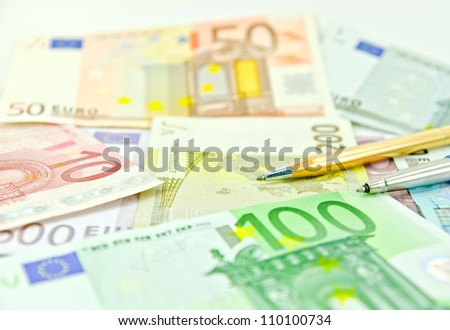 Pen on Euro money - stock photo
