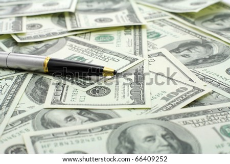 pen on hundred dollars banknotes