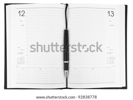 Pen on notebook organizer close-up isolated on white background - stock photo
