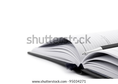 Pen on notebook organizer close-up isolated on white backround - stock photo