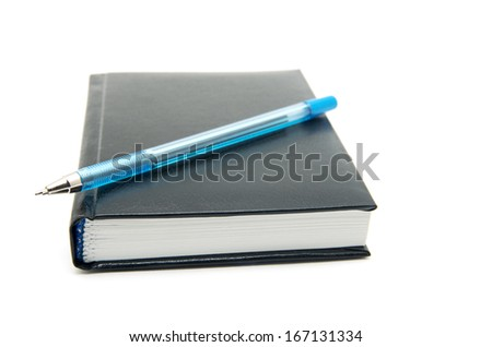 Pen on notebook white background - stock photo
