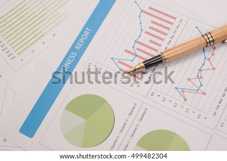 pen on paper report ,business finance, tax, accounting, statistics and analytic research concept