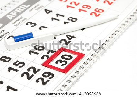Pen on the calendar with the tab on a date. Details business/ Russian translation for: Thursday, Friday