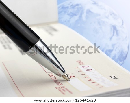 Pen on the Check - stock photo