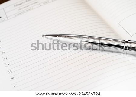 Pen on the diary - stock photo