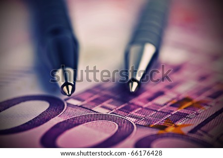 pen on the money euro - stock photo