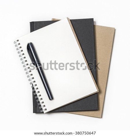 Pen on white, black and brown notebook paper on square background