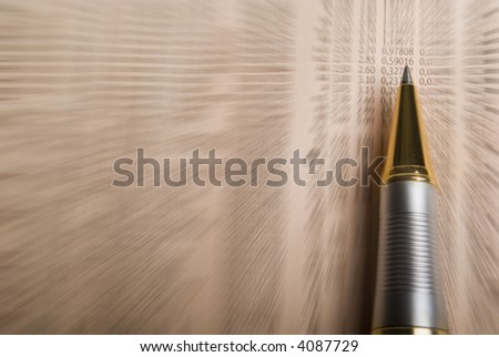 pen over data on a financial  newspaper. radial motion blur tecnique used. - stock photo