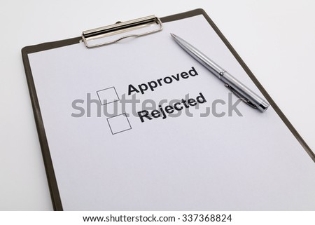 pen over document, select Approved or Rejected. - stock photo