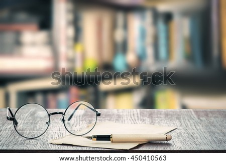 Pen, paper and eyeglasses