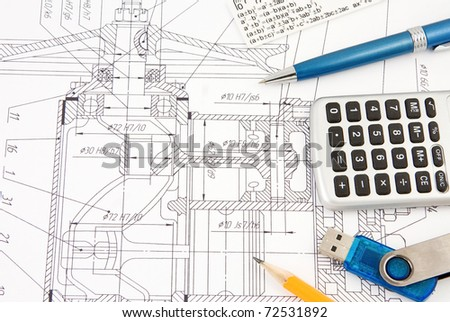 pen, pencil, flash memory and calculator on engineering drafting