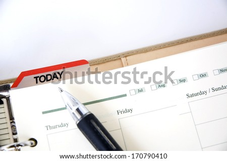 pen point to date today on agenda - stock photo