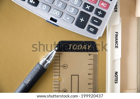 pen point to today tag with calculator put on finance page