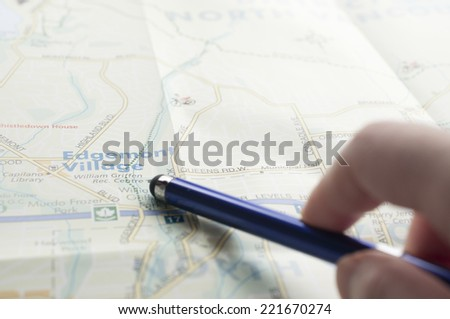 Pen pointing the travel destination - stock photo