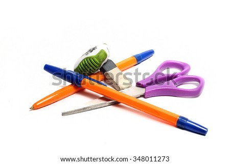 pen,scissors and eraser on a white background