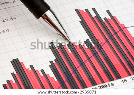 Pen showing diagram on financial report/magazine - stock photo