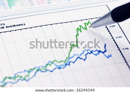 pen showing financial graph