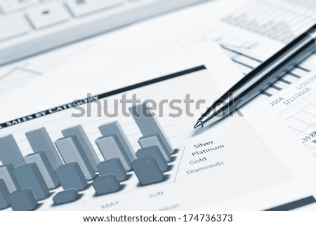 pen, successful growth charts and keyboard. business still life