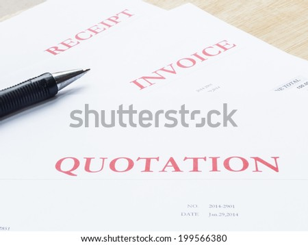 Pen with business document white papers ,quotation,invoice,receipt on wood table - stock photo